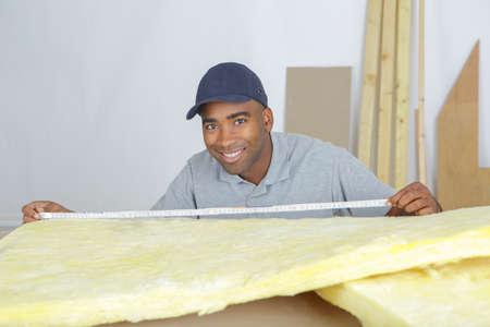 rockwool: Man measuring insulation