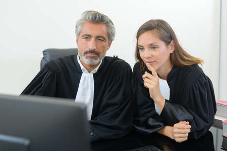 magistrates: Male and female magistrates looking at computer
