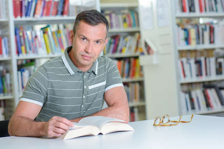 man with a book posing Stock Photo