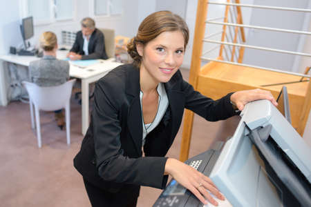 clerical: secretary posing and smiling