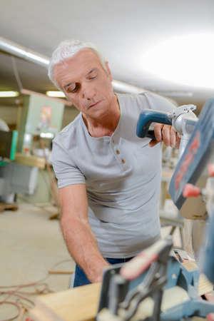 furnishings: Carpenter working alone Stock Photo