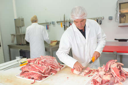resell: cutting the meat Stock Photo