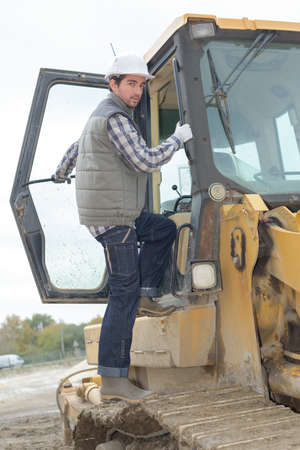 quantities: worker aboard a bulldozer