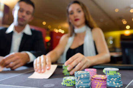 wager: Couple at casino table