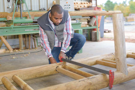 rungs: Man clamping wood together Stock Photo