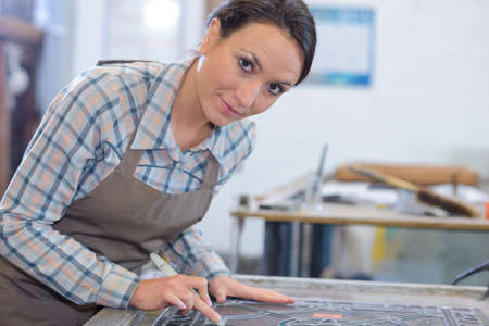 meticulous: Portrait of female artist with stained glass