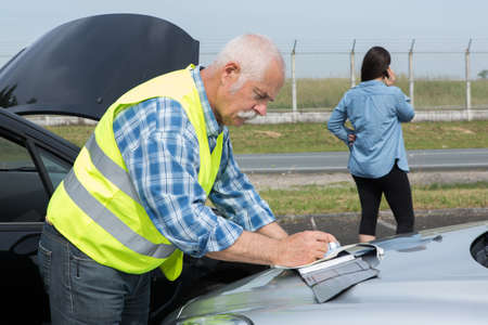 people dealing with car accident Stock Photo
