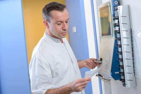 doctor checking machine Stock Photo