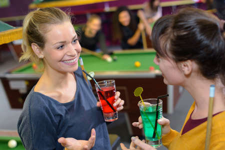 snooker hall: Women in snooker hall Stock Photo
