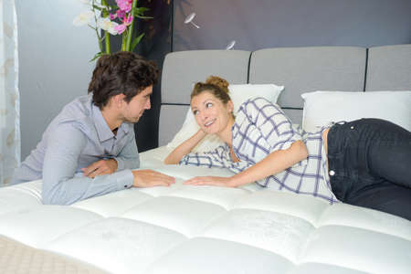 cushioned: Couple viewing new mattress