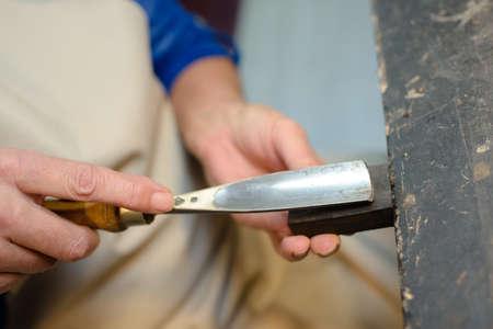 gouge: Closeup of chisel on wood