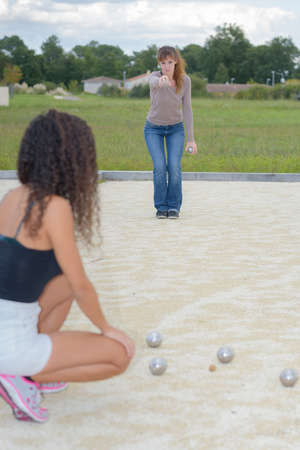 Two ladies playing petanque Stock Photo