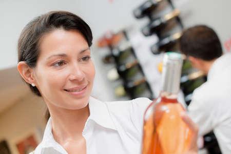moderation: reading the wine bottle Stock Photo
