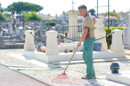 groundskeeper: raking in the cemetary