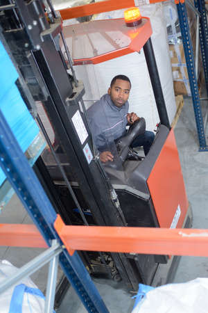truck driver: Downward view of man driving forklift