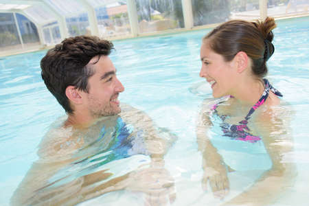 sheltered: Man and woman in pool
