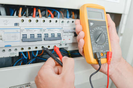 Probes of multimeter in fusebox