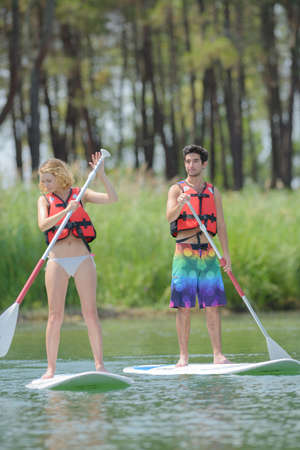 boarders: stand up paddle boarders Stock Photo