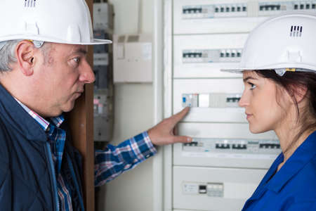 fusebox: Man showing fusebox to apprentice