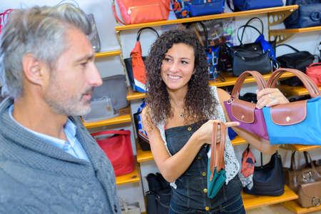 buying: a couple buying handbags Stock Photo