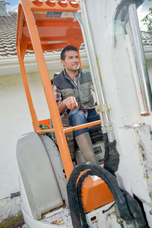 Busy worker driving a forklift
