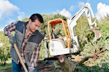 back hoe: Digging up the garden