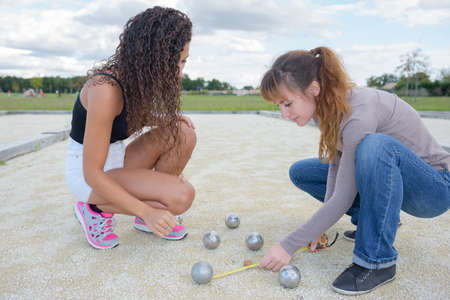 girls playing petanque Stock Photo