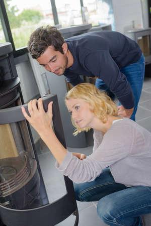 woodburner: Couple examining a woodburner