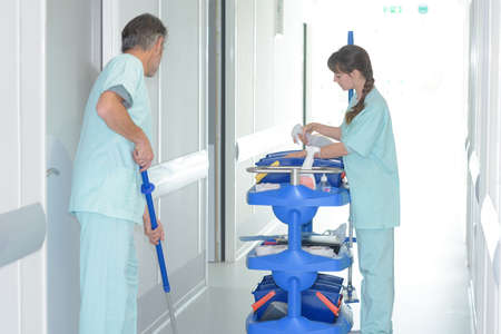 Cleaners at work in hospital