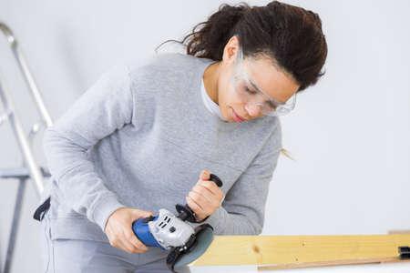 sander: Worker using electric sander