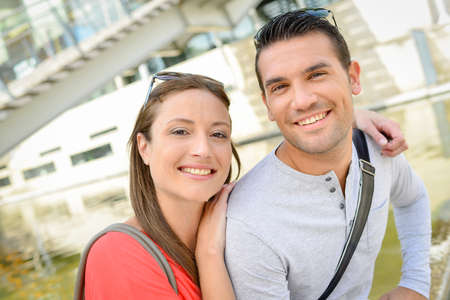 Couple posing for photograph outdoors