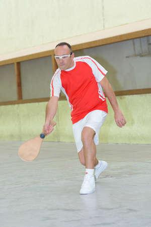 Sportsman with wooden bat