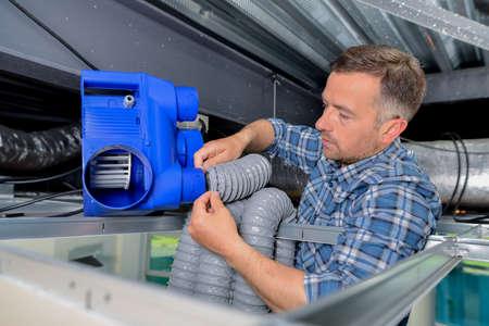 heat register: Man installing air conditioning