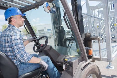 truck driver: Man driving forklift truck