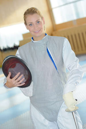 fencer on uniform posing