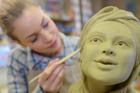 sculptor: clay sculptor at work