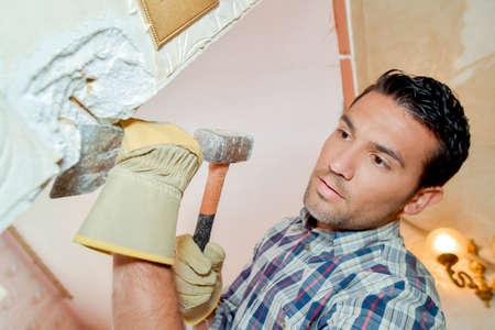 man breaking wall
