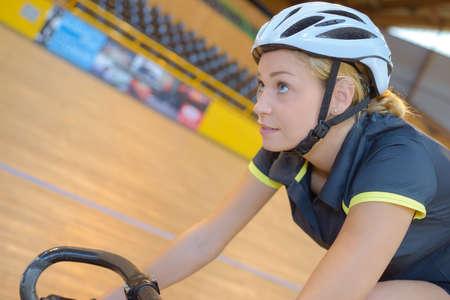 woman riding her bike Stock Photo