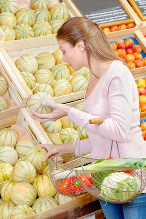 shopper: Shopper choosing a melon