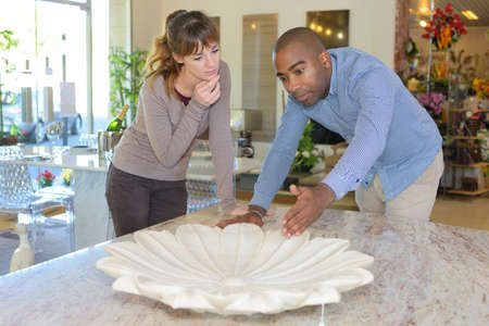 Centrepiece: Couple looking at flower design centrepiece Editorial