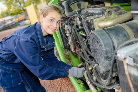 Lady adjusting engine component
