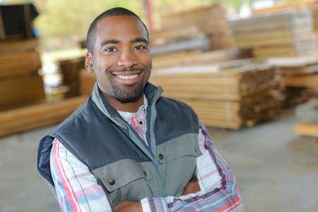 Portrait of man in woodyard