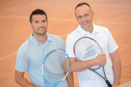 Portrait of two men on tennis court Stok Fotoğraf