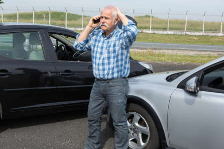 retired man desperate on the phone after trafic accident