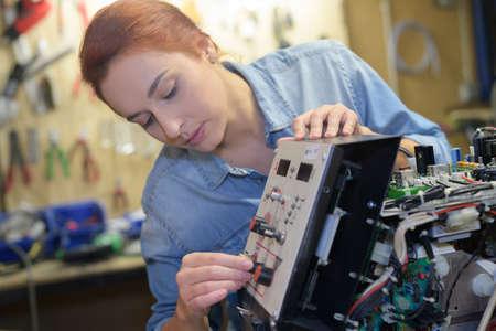display machine: Technician working on machines control panel