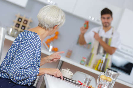 Man checking condiment for womans meal