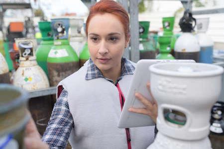 pretty employee checking gas tanks Reklamní fotografie