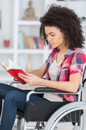 handicapped woman reading the book Stock Photo