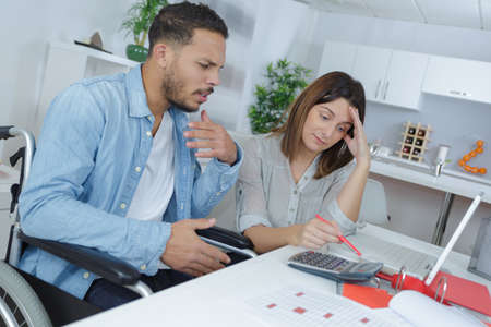 couple at home grinding out some numbers Stockfoto