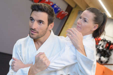 clinch: Couple in martial arts hold